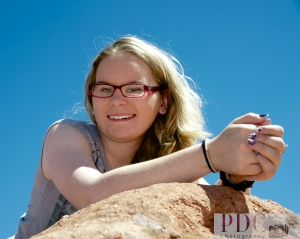 Libby laying on top of a rock at Garden of the Gods