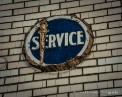 "The torch has been chiseled away; and it appears the ""Service"" emblem has been tampered with as well"